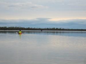Kayaking across the still lagoon